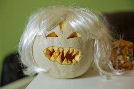 Halloween Pumpkin . Halloween pumpkin grinning in the most evil fashion . Spooky Halloween Jack o Lantern . Pumpkin on dry straw in autumn on a background . In preparation for Halloween