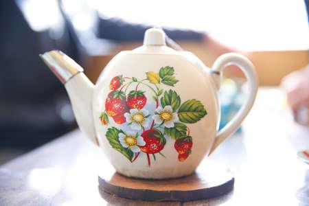 Stack of antique ceramic teapot selectiv focuse .