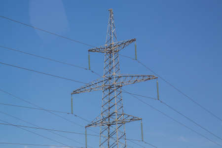 Electricity transmission power lines High voltage tower . Power line high voltage post with blue sky background.Electricity pylon on nature background