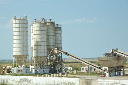 Sand and stone destined to the manufacture of cement in a quarry.Cement manufacturers mine and process raw materials and put them through a chemical reaction process to create cement