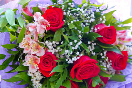 Red flower picture close up in the bouquet . Bouquet of fresh red, white roses . bouquet of multicolored roses . 写真素材