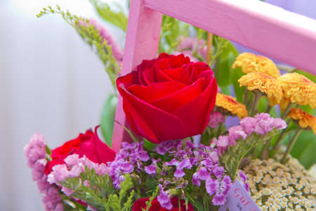 Pink bouquet of multicolored roses . Red , purple flower picture close up in the bouquet. Ribbon . Pink bouquet of fresh purple, red, Pink, white , blue, orange roses . 写真素材