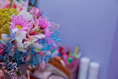 Bouquet of multicolored roses . Pink flower picture close up in the bouquet. Ribbon . Bouquet of fresh Pink, white , blue, orange roses .
