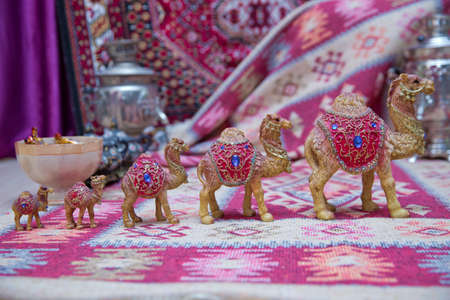 Decorated camel , used generally in indian culture, used as a souvenir . Beautiful camel souvenir as sold in the souq of Baku , Azerbaijan Emirates . 版權商用圖片