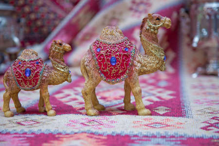 Decorated camel , used generally in indian culture, used as a souvenir . Beautiful camel souvenir as sold in the souq of Baku , Azerbaijan Emirates .