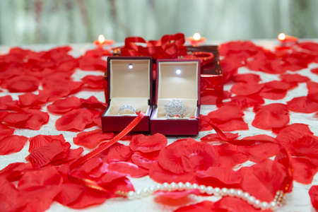 Engagement rings inside the red box . Red box and inside it is another small box with a ring. Concept for Valentine's Day or the engagement.