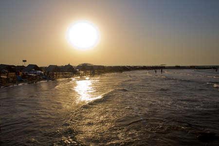 Beautiful golden sunset over the beach. Colorful dawn over the sea. Nature composition.sunset beach ocean panorama . Coast beach in the Caspian Sea near Novxani at sunrise.Azerbaijan