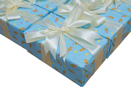 Blue gift boxs with a white ribbon and bow . Gift, isolated on white dackground .Group of blue gift boxes with silver ribbons isolated on white background with clipping path
