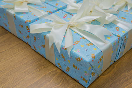 Blue gift boxs with a white ribbon and bow . Gift, isolated on wooden background .Group of blue gift boxes with silver ribbons isolated on white background with clipping path 版權商用圖片