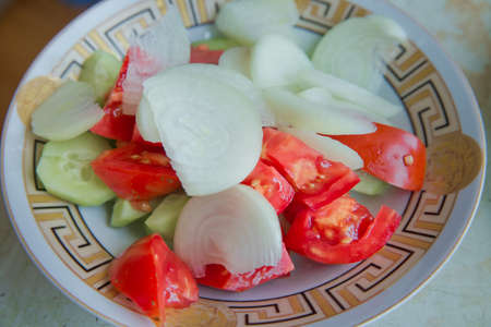 Purslane salad with tomatoes and cucumbers . Tomato and cucumber salad . fresh vegetable salad with tomato, cucumber and green onion . Peeled cucumber, tomato, onion salad Stock fotó