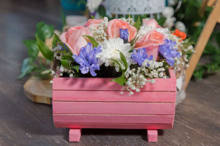 Mix color roses in the pink wooden box . Rustic Wedding Styled Photography Pink white, purple Coral White Flowers Wood Stok Fotoğraf