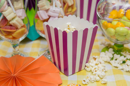 A wide classic box of theater popcorn. Popcorn in striped bucket Stock fotó