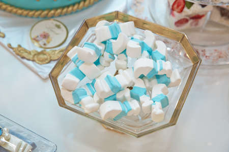 White and cyan Fluffy Round Marshmallows as a background. Sweet Food Candy Background as poster. wallpaper, backdrop macro
