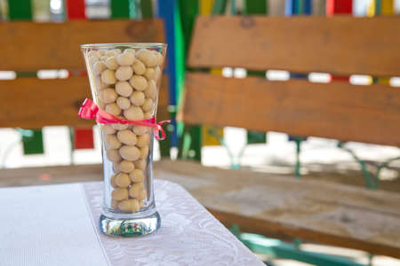 white chocolate balls with almond heart. in a glass jar .In a round white chocolate glass