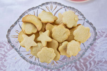 Star biscuits inside the plate. Plate with Christmas star cookies, sweet snack for kids, food for holidays