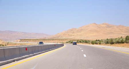 Empty asphalt road across vast hilly landscape of Azerbaijan .endless scenic road across somewhere in Azerbaijan