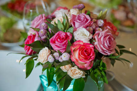 Pink, white, yellow flower bouquet . white, purple roses .Roses with bokeh in the background,Roses for Valentines Day . Bouquet flower decor for valentine . Purple, white, yellow flowers.