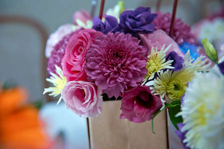 Pink, white, yellow flower bouquet . white, purple roses . Purple, white, yellow flowers.