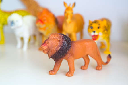 Brown Plastic Toy Lion on White Background . rubber lion on white background with clipping path 스톡 콘텐츠