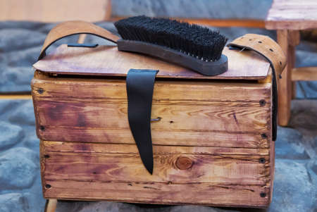Large black Horse Hair Shoe Brush and polishing shoes on a wooden table . Shoe brush on wooden table. Footwear care item . Stok Fotoğraf