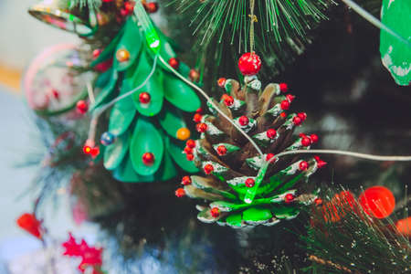 Beautiful Christmas ornaments. Christmas decoration in the form of a Fallen pinecone, in the blue background, branches Christmas tree. Fallen pinecone Reklamní fotografie