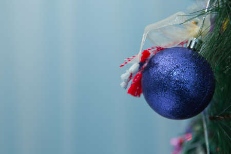 Christmas ball on the branches fir. Photo Christmas blue ball on a Christmas tree branch on a background of the night city lights 스톡 콘텐츠 - 129927946
