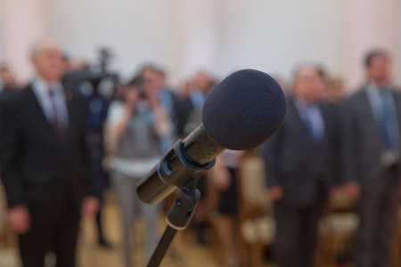 Close up of microphone in concert hall or conference room .Wired microphone set up on the front of conference room close up with blurred background. Wired microphone close up with copy space Stock fotó