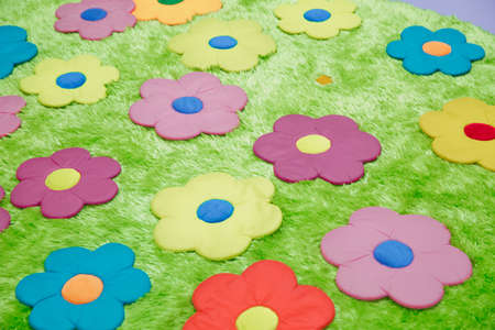 Baby carpet with flowers . green rugs . green floral carpet Banque d'images - 129927911