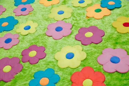 Baby carpet with flowers . green rugs . green floral carpet Banque d'images - 129927908