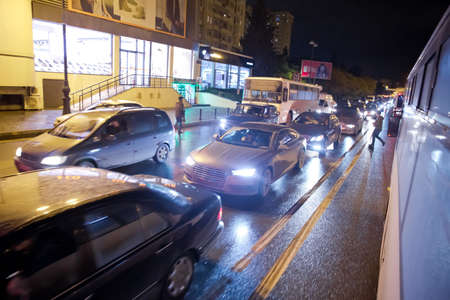 Traffic jam in the rush hour . Evening traffic jam in Baku on one of streets in the downtown . Queue of cars on the street during the rush hour