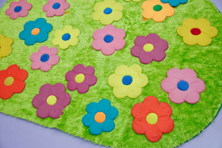 Baby carpet with flowers . green rugs . green floral carpet Banque d'images - 129927913