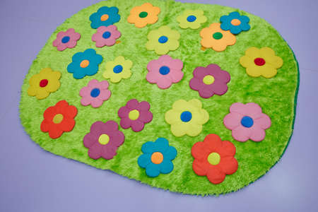 Baby carpet with flowers . green rugs . green floral carpet Banque d'images - 129927844