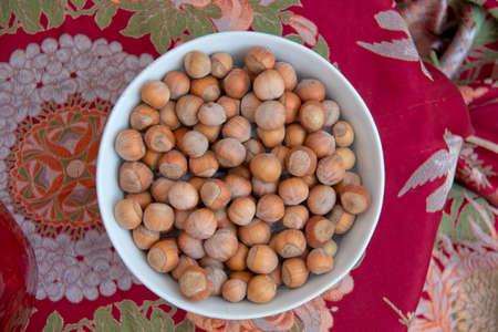 Hazelnuts. Stack of hazelnuts. Food background. Hazelnuts texture. Top view . Hazelnut Nut Health Organic Brown Filbert Autumn Background Concept Imagens