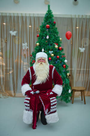 Santa against home with christmas tree 스톡 콘텐츠