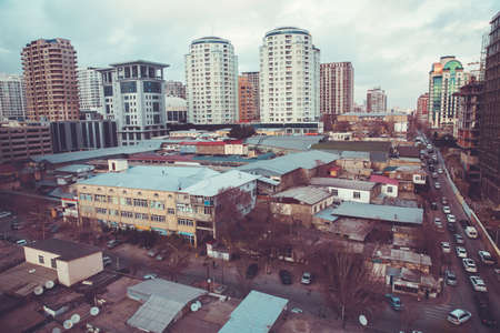 Old houses are new buildings . view from above . cloudy evening . In the evening . Cold building background . Old houses are newly built buildings