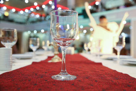 Empty glasses set in restaurant. Part of interior . wine glasses on the table in front of the empty wineglass. Empty wine glasses on table against blurred background