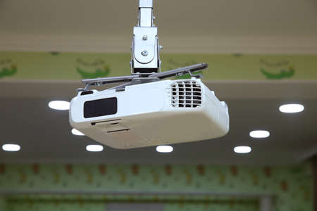High quality Projector 4K at the ceiling in conference room with copy space.Projector at business conference or lecture.For offices and training facilities. Irradiation.