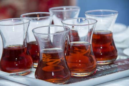 tea in a glass of pears inside the pod . Tea in a armudu glass . armudu tea on tray