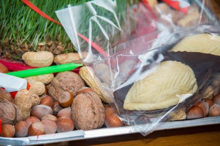 Navruz Nowruz holiday, the spring New Year holiday. Shakerura is in the background Xoncha . Isolated shot of Novruz holiday cookie shekerbura .