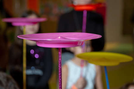 A collection of spinning purple plates . Fun with Spinning Plates .balancing a spinning plate.