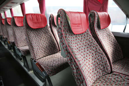 Open double interior of new modern red chairs bus . interior of new modern bus . bus seat Safety belts . Seating in the interior of the bus, transportation and comfortable travel