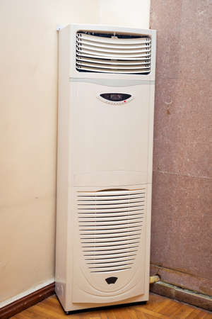 big white standing air conditioner . air conditioner on a stand .Room Big Huge Air Conditioner AC in Meeting Office Building