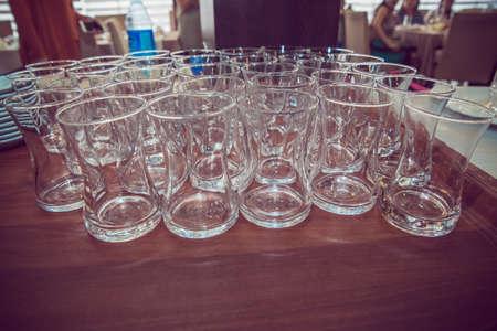 armudu glass . Empty tea glass wooden table .
