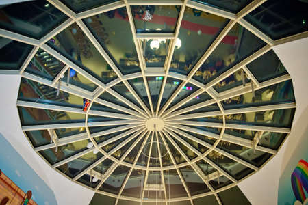 the metal and glass round roof of a mall. Modern glass roof .modern art from glass and metal, roof background