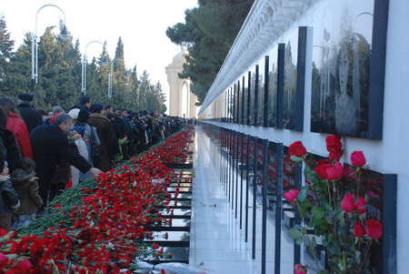 BAKU, AZERBAIJAN - JANUARY 20 2009 Flowers laid in respect by mourners on marble graves at the 20th January Monument in Baku, on the anniversary of massacre of citizens in the capital of Azerbaijan