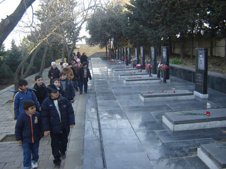 BAKU, AZERBAIJAN - JANUARY 20 2007 Flowers laid in respect by mourners on marble graves at the 20th January Monument in Baku, on the anniversary of massacre of citizens in the capital of Azerbaijan