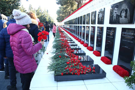 Azerbaijan, Baku, January 18, 2020. People visiting Alley of Martyrs on anniversary of 20th January tragedy when Soviet Army attacked Baku in 1990, killing 137 people, wounding 744 Redakční