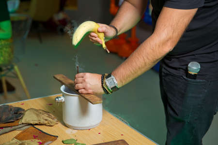 Nail with banana on board. Nitrogen frozen bananas. Submerse a banana in liquid nitrogen -320 F and notice how cold it becomes. You can hammer a nail into wood before it shatters like glass.