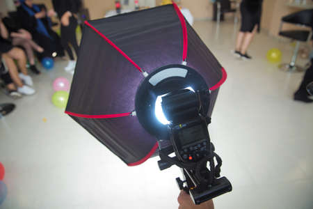The SMDV Diffuser-40 is a 40cm hexagonal softbox designed to fit small camera flashguns . The birthday uses a soft-box for shooting . Soft-box Diffuser for Speed-light Speed-lite
