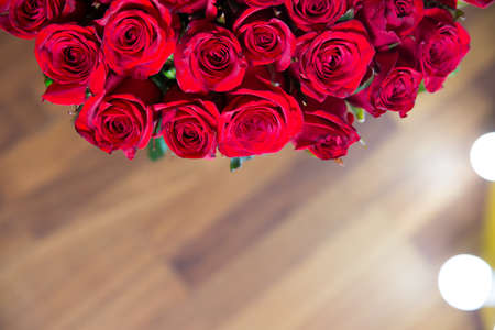 Beautiful rose flower in garden. Rose blurred background. Roses flower texture. Red rose. Bouquet of red roses. copyspace . The letter A is written with white flowers.